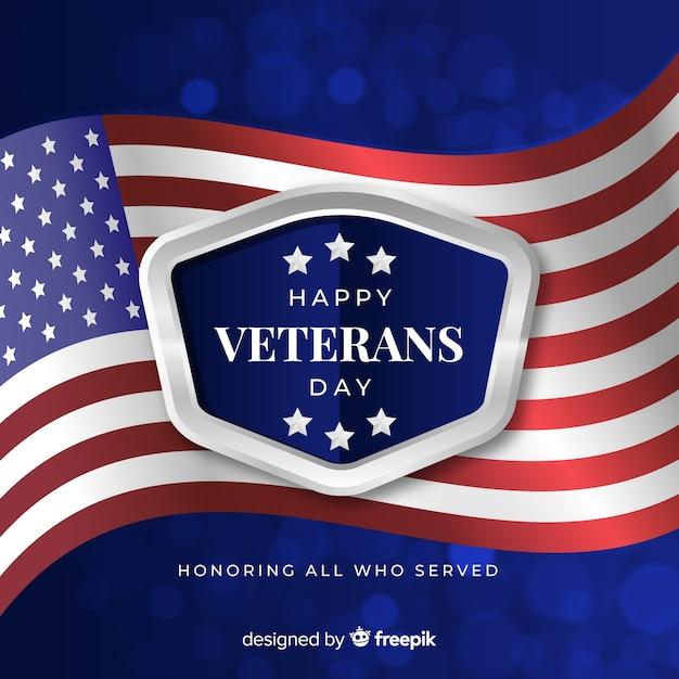 Fondo del día de los veteranos con bandera realista vector gratuito
