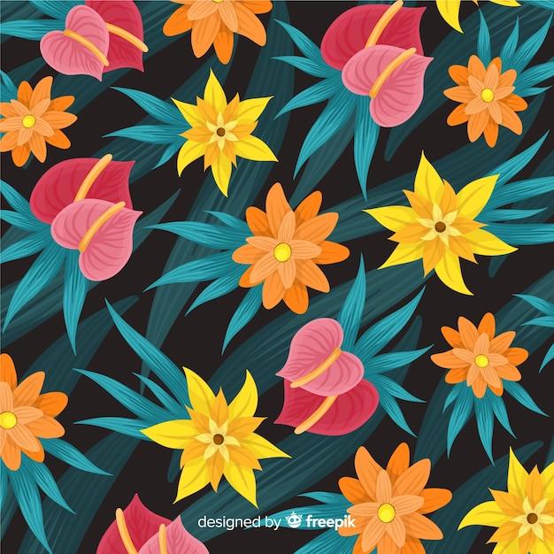 Fondo de estampado de flores tropicales coloridas vector gratuito