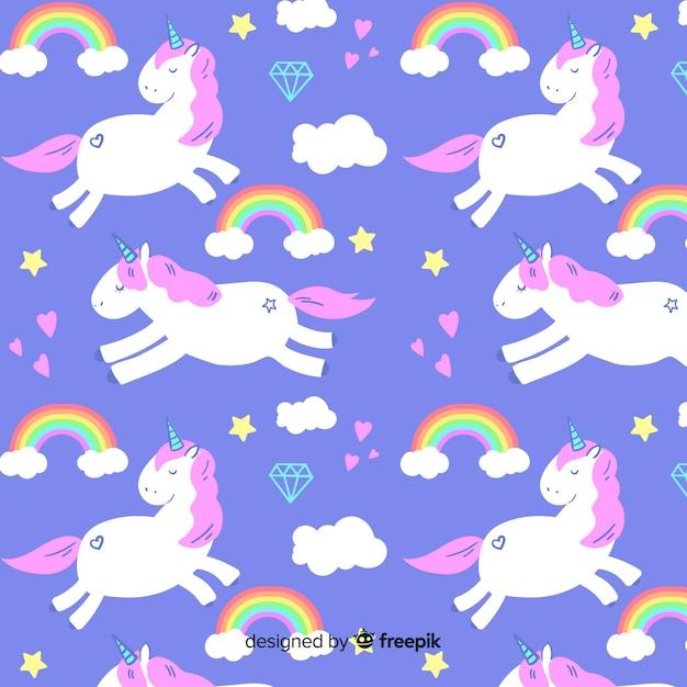 Fondo de estampado de unicornio dibujado a mano vector gratuito