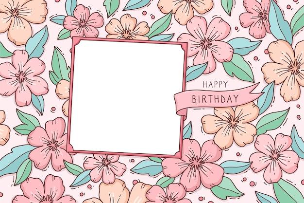 Fondo floral con saludo de feliz cumpleaños vector gratuito