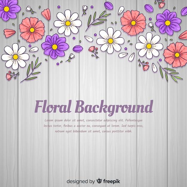 Fondo de flores dibujado a mano vector gratuito