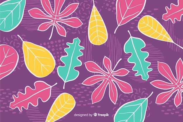Fondo de flores tropicales dibujadas a mano vector gratuito