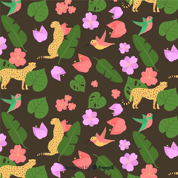 Fondo de hojas y flores tropicales vector gratuito