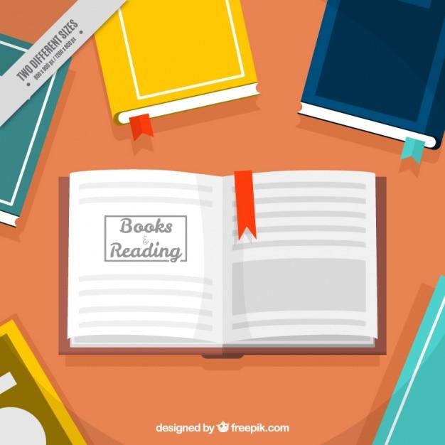 Fondo de mesa con libros de colores y libro abierto | Descargar ...