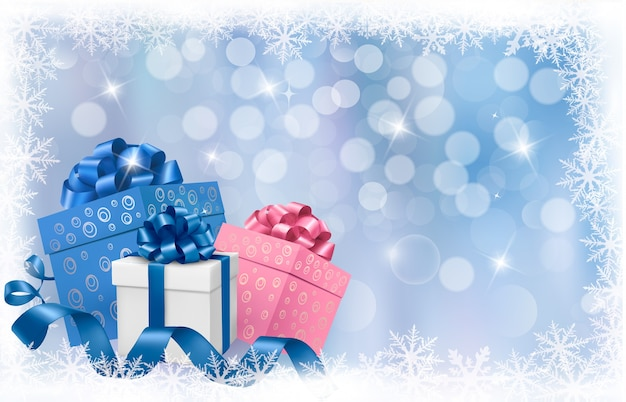 Fondo de navidad con cajas de regalo y cintas azules. Vector Premium