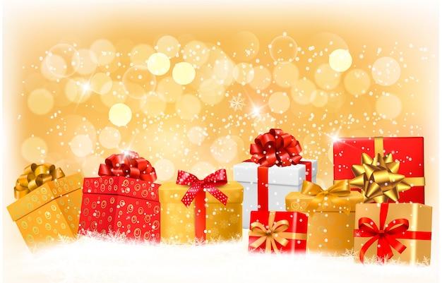Fondo de navidad con cajas de regalo y copos de nieve. Vector Premium