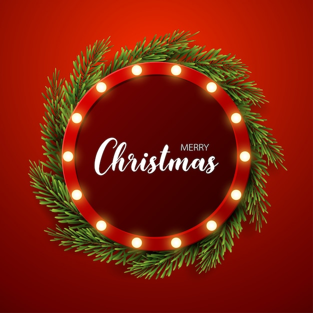 Fondo de navidad con ramas de abeto, signo de luz sobre fondo rojo Vector Premium