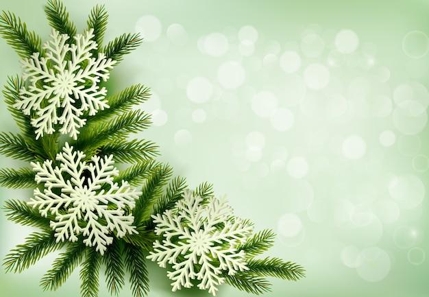 Fondo de navidad verde con ramas de árboles de navidad y copos de nieve. Vector Premium