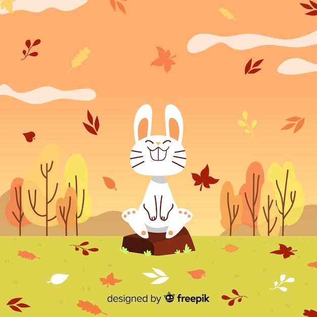 Fondo otoñal dibujado con conejo vector gratuito