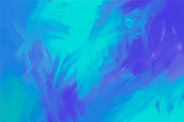 Fondo pintado a mano en colores morado y azul Vector Premium
