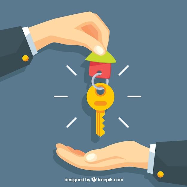 Fondo plano de mano sosteniendo llave de casa vector gratuito