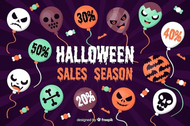 Fondo plano de venta de halloween con globos vector gratuito