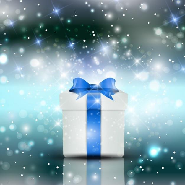 Fondo resplandeciente de navidad con caja de regalo for Pc in regalo gratis