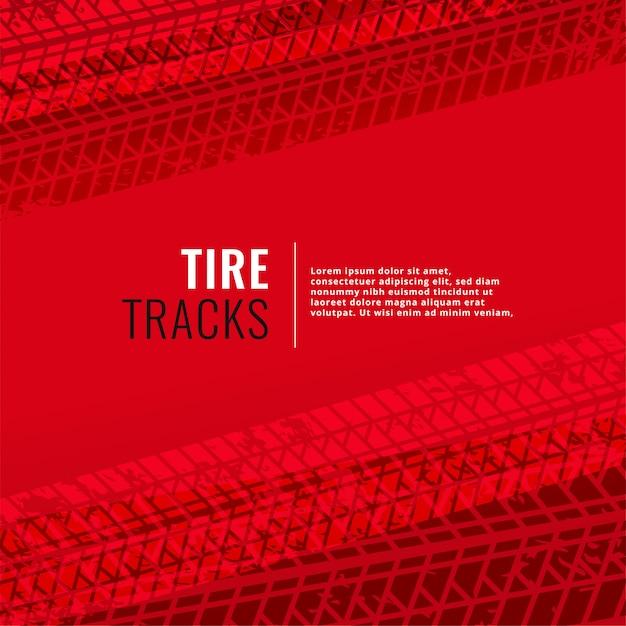 Fondo rojo con marcas de huellas de neumáticos vector gratuito