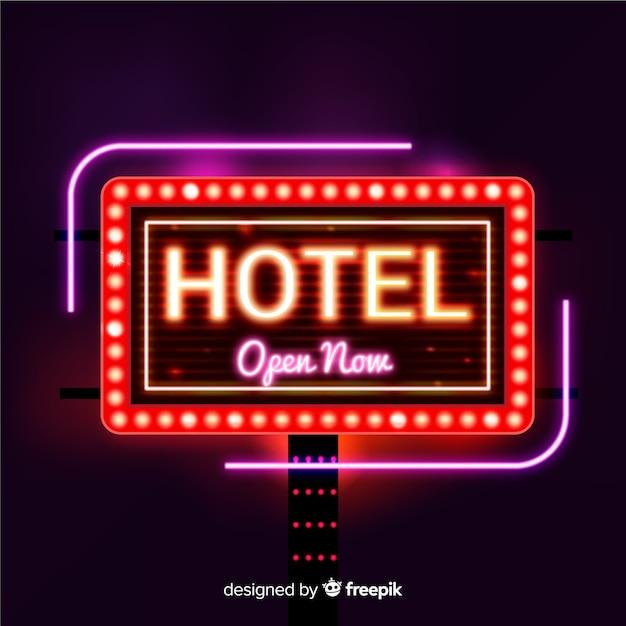 Fondo señal hotel de neón realista vector gratuito