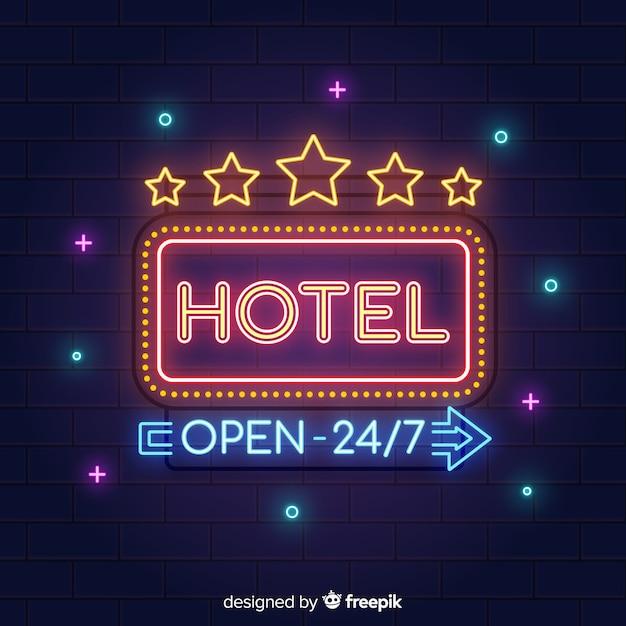 Fondo señal realista hotel de neón vector gratuito