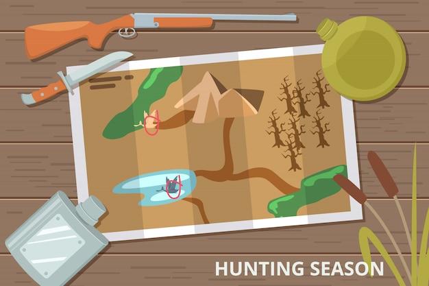 Fondo de temporada de caza con mapa en mesa de madera y equipo de caza Vector Premium