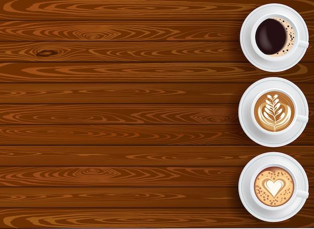 Fondo con tres tazas de café en la vista superior de la mesa de madera con lugar para texto editable vector gratuito
