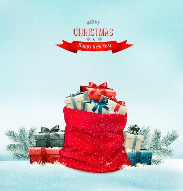 Fondo de vacaciones de navidad con un saco lleno de cajas de regalo. Vector Premium