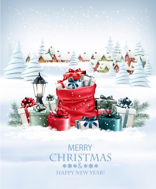 Fondo de vacaciones de navidad con un saco rojo regalos completos y un pueblo de invierno. . Vector Premium