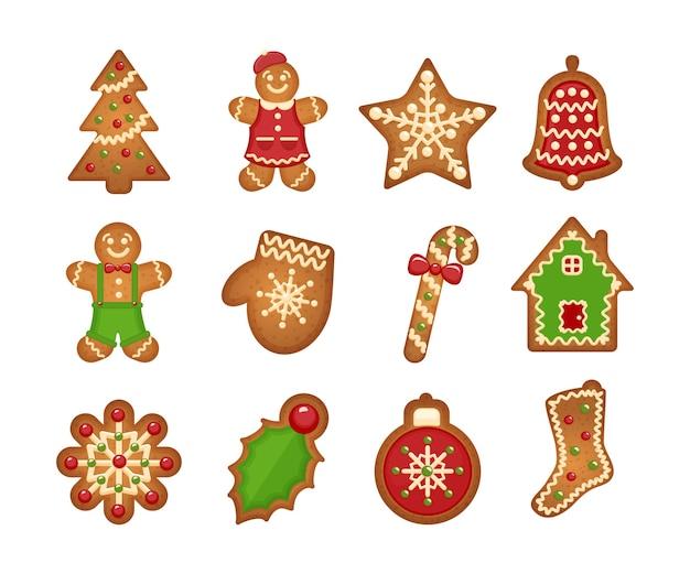 Galletas de jengibre de navidad sobre fondo blanco. árbol de navidad y estrella, campana y casa. vector gratuito