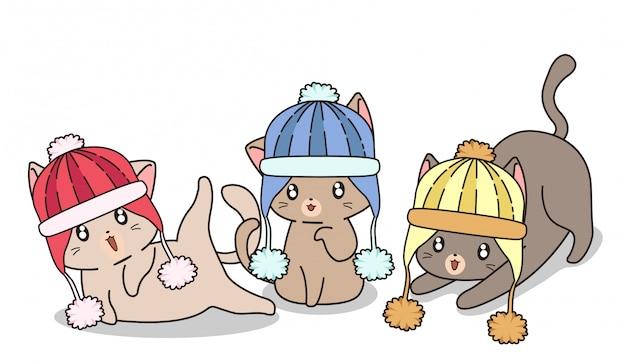 Gatos adorables llevan sombrero de punto Vector Premium