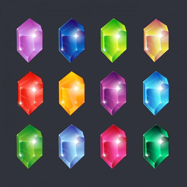 Gemas mágicas. piedras de gemas joyas diamantes piedras preciosas esmeralda rubí zafiro mirada vidrio transparente brillante aislado conjunto de iconos de dibujos animados Vector Premium
