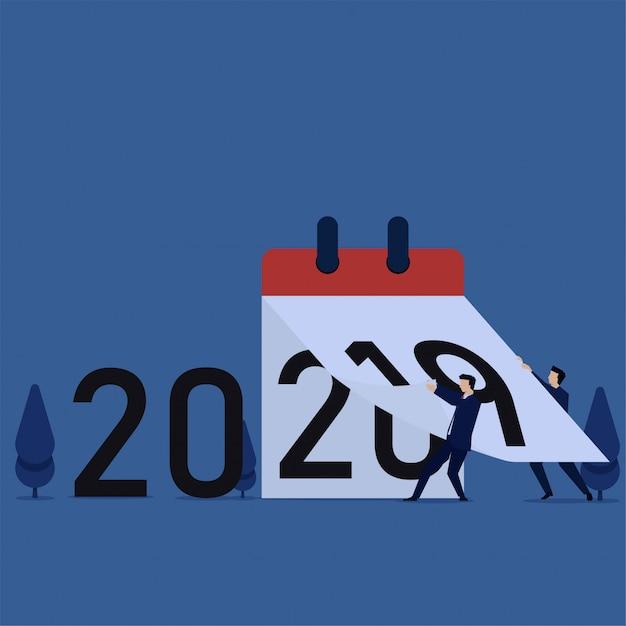 La gente cambia el calendario de 2019 a 2020 Vector Premium