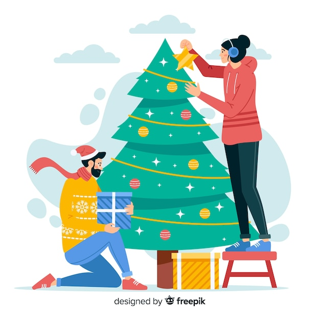 Gente decorando árboles de navidad al aire libre vector gratuito