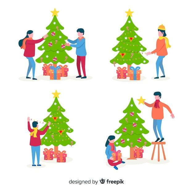Gente decorando árboles de navidad vector gratuito