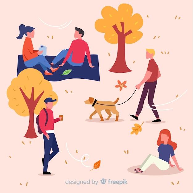 Gente en el parque en otoño vector gratuito