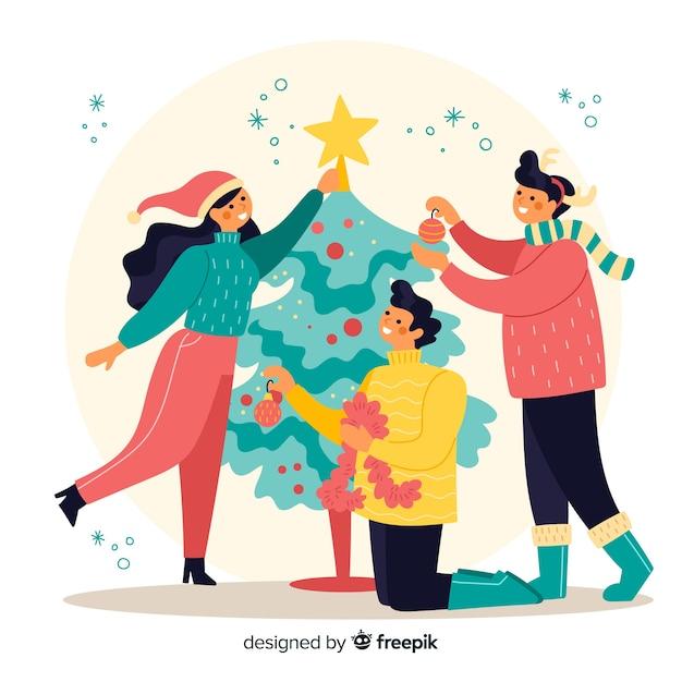Gente que adorna la ilustración del árbol de navidad vector gratuito