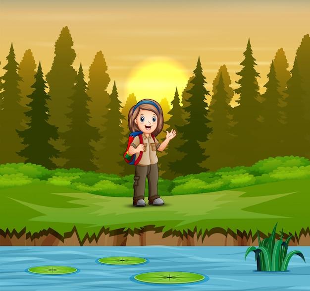 Girl scout en uniforme de senderismo en el bosque Vector Premium