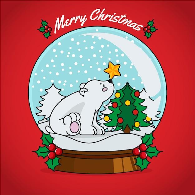 Globo de bola de nieve de navidad dibujado a mano vector gratuito