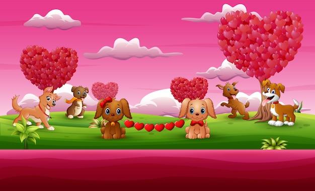 Grupo de la celebración del perro un día de san valentín en el jardín rosado. Vector Premium