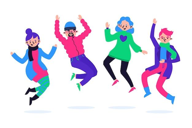 Grupo de jóvenes vistiendo ropa de invierno saltando vector gratuito