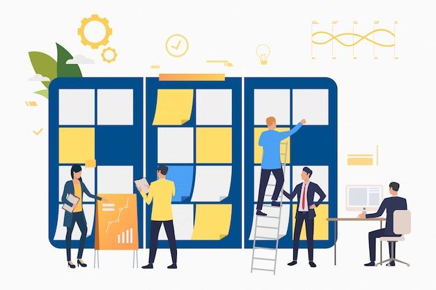 Grupo de marketing trabajando en presentación. vector gratuito