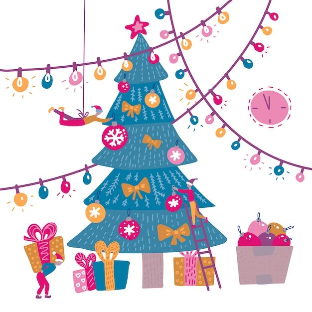Grupo de personas pequeñas que decoran el árbol de navidad Vector Premium