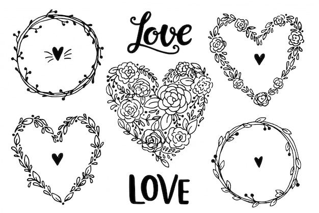 Guirnaldas de corazón vintage rústico dibujado a mano. colección floral Vector Premium