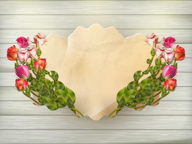 Hermoso ramo de rosas multicolores y una tarjeta de cartón vintage sobre una tabla de madera, primer plano, fondo listo. archivo incluido Vector Premium