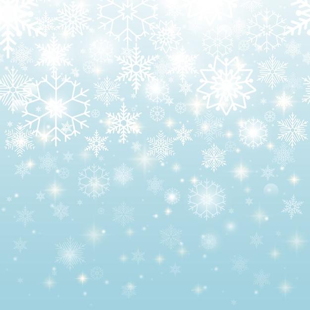 Hermosos copos de nieve blancos en diseño gráfico de patrones sin fisuras sobre fondo azul cielo. vector gratuito