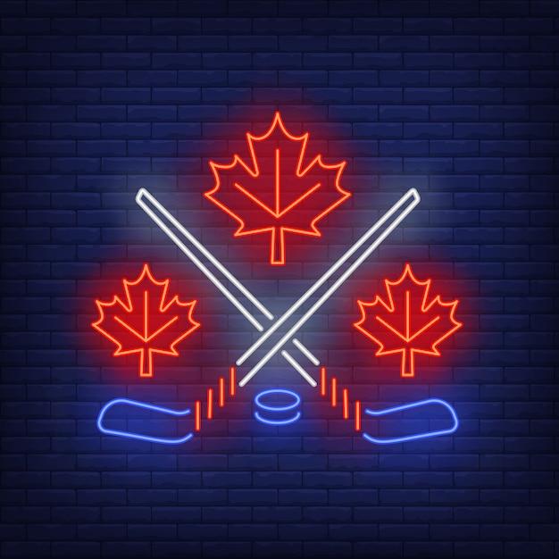 Hojas de arce con palos de hockey cruzados letrero de neón vector gratuito
