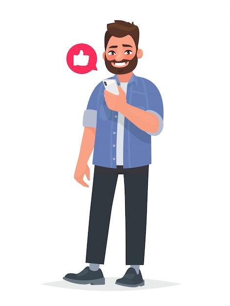 Hombre barbudo está sosteniendo un teléfono inteligente en la mano. comunicación en la red, sitios de citas y redes sociales. Vector Premium