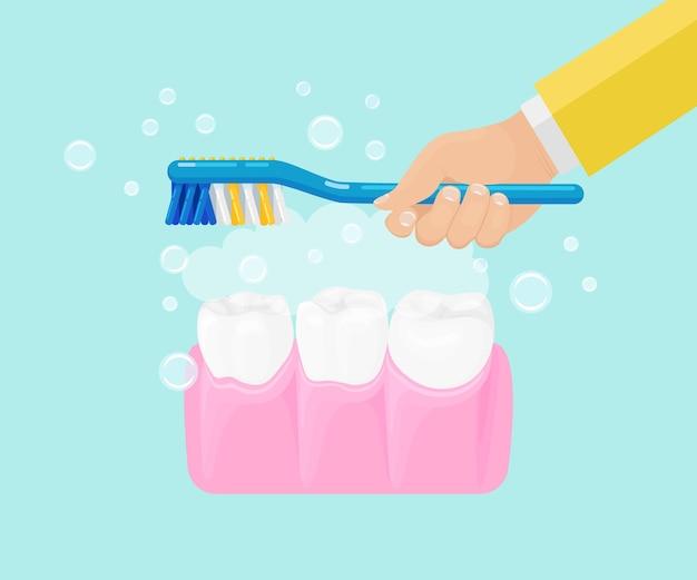 Hombre cepillarse los dientes con cepillo de dientes con pasta de dientes Vector Premium