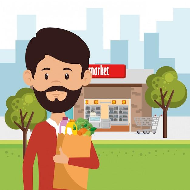 Hombre con supermercado en bolsa de compras | Vector Gratis