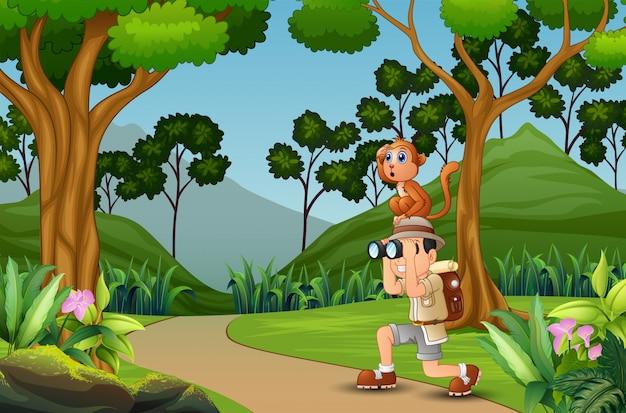 Hombre feliz explorador con un mono en la selva Vector Premium