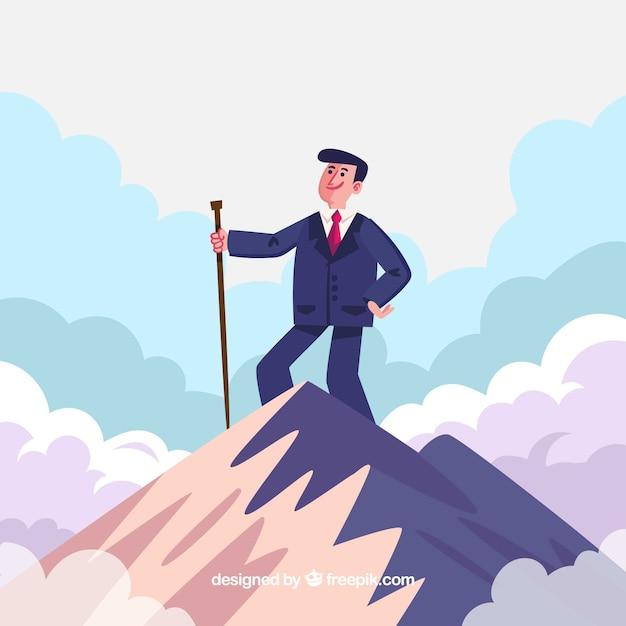 Hombre de negocios con un baston en la cima de una montaña vector gratuito