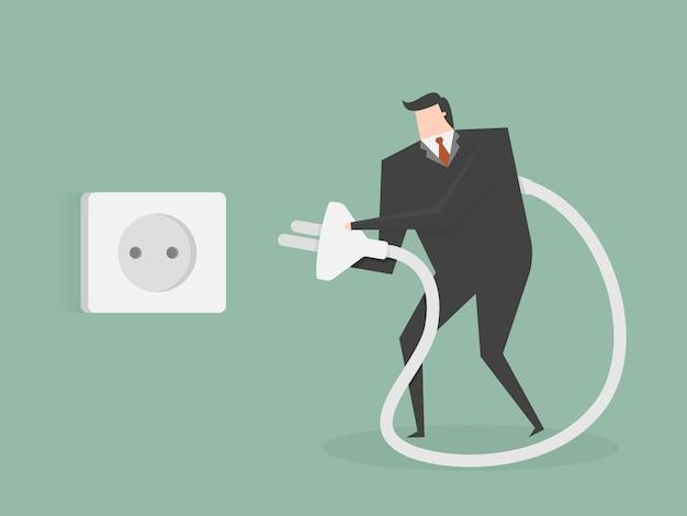 Hombre de negocios conectando un enchufe vector gratuito