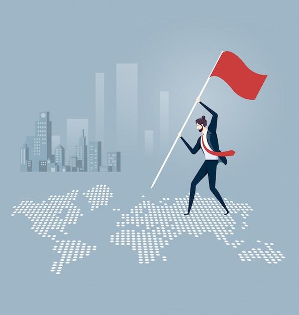 Hombre de negocios que pone una bandera encima de un mapa del mundo Vector Premium