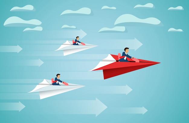 El hombre de negocios se sienta en mosca que compite del avión de papel rojo hasta el cielo va a la meta del éxito Vector Premium